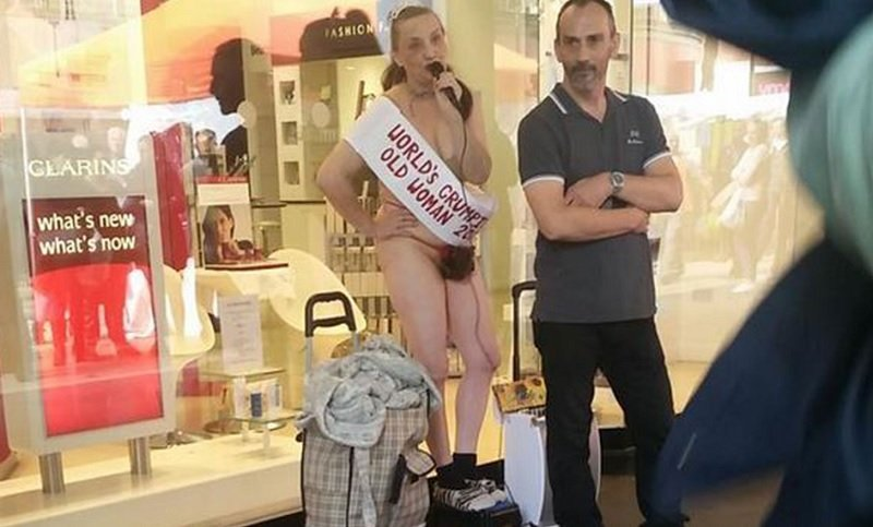 Scantily Clad Woman Glues Herself To Department Store In Bizarre Protest