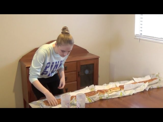 Model Devours Five Foot Subway Sandwich In Under 10 Minutes