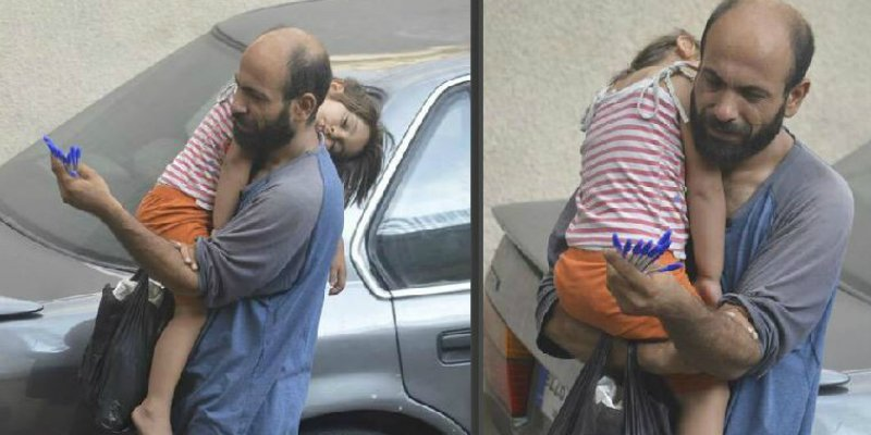Refugee Dad Sells Pens While Daughter Naps On His Shoulder: Photo Goes Viral And Raises $115,000 From Around The World